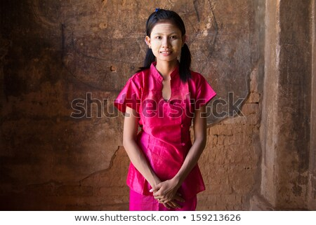 Portrait of traditional Asian Burmese woman praying, standing inside a temple, low light, Bagan, Mya Stock photo © szefei