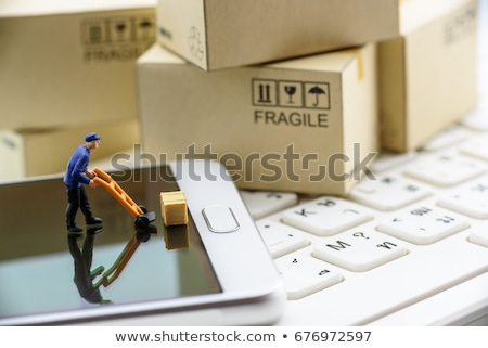 Miniature courier figurines packaging  Stock photo © mady70
