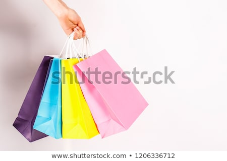 close up of hand holding shopping bags Stock photo © dolgachov