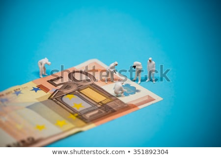 specialists inspecting 50 euro banknote fraud concept stock photo © kirill_m