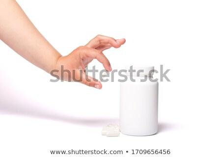 Stock photo: Child's Hand Holding Pills