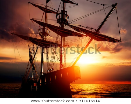 Pirate ship on peaceful ocean at sunset. Stock photo © maxmitzu