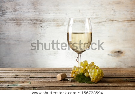 Glass with white wine on the wooden background Stock photo © Alex9500