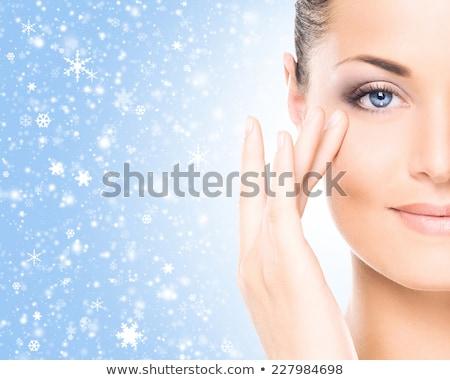 Beauty woman over winter background Stock photo © konradbak