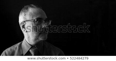 serious mature businessman thinking on white stock photo © ozgur