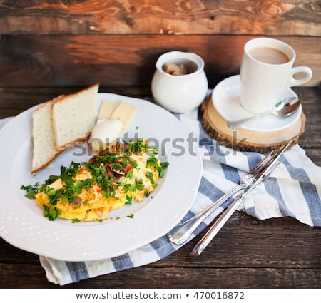 Latte cap and Herb omelette with chives and oregano sprinkled wi Stock photo © Yatsenko