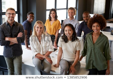 Three business colleagues smiling. Stock photo © IS2