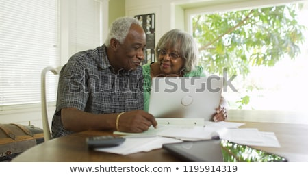 Woman and senior man looking at laptop Stock photo © IS2