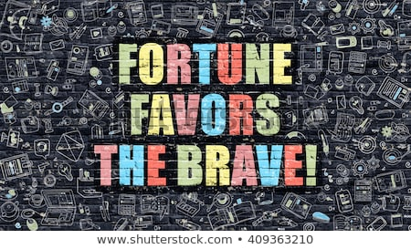 Fortune Favors the Brave on Dark Brick Wall. Stock photo © tashatuvango