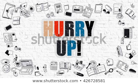 multicolor hurry up on white brickwall doodle style stock photo © tashatuvango
