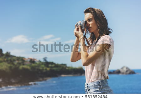 Woman taking a picture of the sea Stock photo © IS2