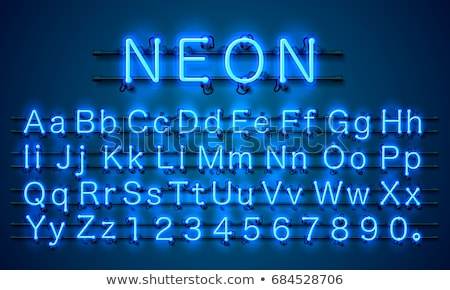 Bright Neon Alphabet on Blue Background. Vector Letter, Number and Symbol with Shiny Glow Effect Lay stock photo © articular