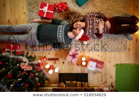 Joven decorado Navidad luces mentiras piso Foto stock © artjazz