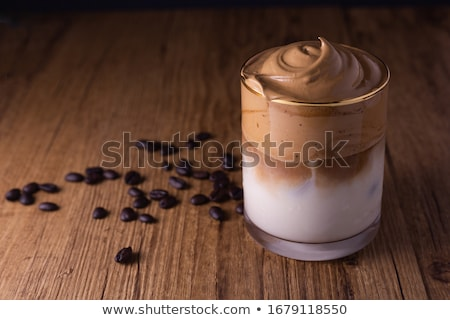 Cup of coffee with whipped cream Stock photo © dash