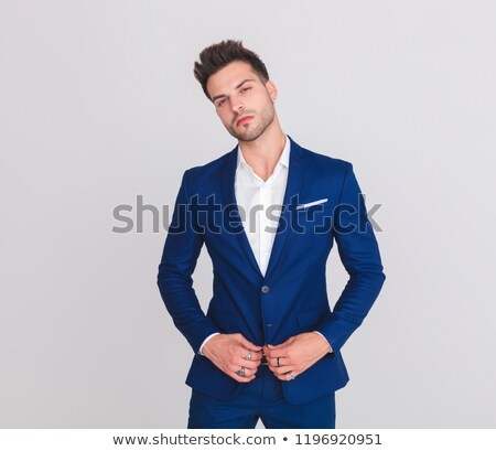 portrait of proud attractive man buttoning his blue suit Stock photo © feedough