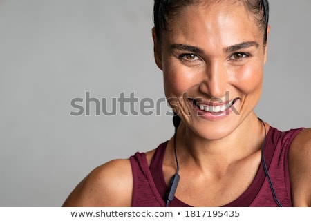 Close up of laughing young sportswoman Stock photo © deandrobot