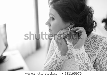 beautiful woman with earring, ring and pendant Stock photo © dolgachov