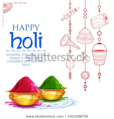 happy holi festival greeting with bowl of gulal (powder color) b Stock photo © SArts