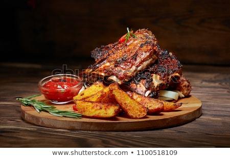 Frito carne de porco costelas framboesa alecrim raso Foto stock © AGfoto