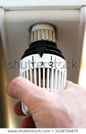 Person Adjusting Temperature On Radiator Stock photo © AndreyPopov