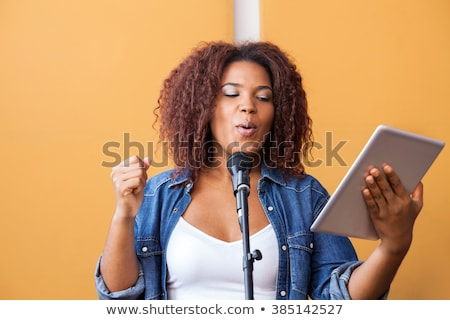 Music instruments and tablet with recording app Stock photo © ra2studio