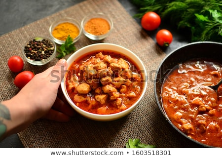 Traditional Indian chicken tikka masala spicy curry meat food in cast iron pan Stock photo © dash