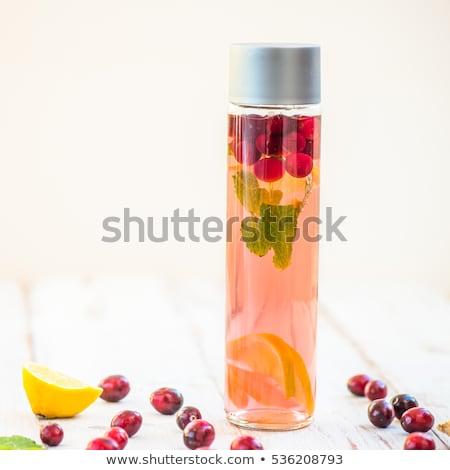 Stockfoto: Detox water in bottles with cranberrie, ginger, lemon, mint