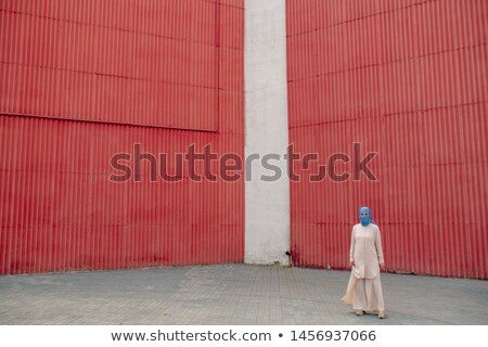 Young Arabian muslim woman in casualwear and hijab in urban environment Stock photo © pressmaster