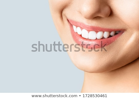 Woman's smile. Healthy white woman's teeth and a dentist mouth mirror close-up. Dental hygiene, oral Stock photo © serdechny