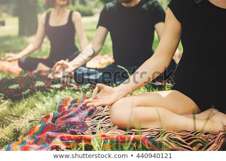 Young yoga practitioners in group doing yoga on nature, healthy  Stock photo © Freedomz
