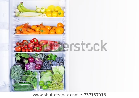 Opened refrigerator full of vegetarian healthy food, vibrant colour vegetables and fruits inside on  Stock photo © galitskaya