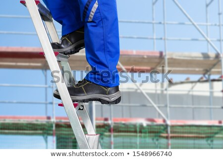 close up of a handy repair man standing on steel ladder stock photo © andreypopov
