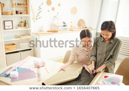 Happy young woman and her daughter discussing gifts that they bought Stock photo © pressmaster