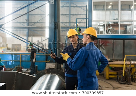 Male Worker Inspecting Pipes Stock photo © AndreyPopov