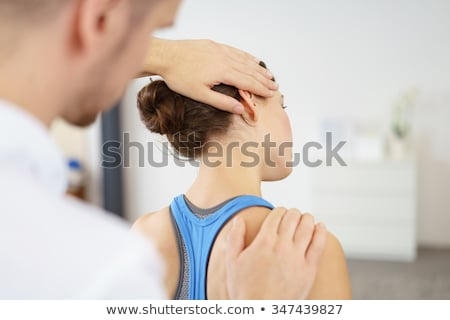 Physical therapist working on head and shoulders of patient Stock photo © Kzenon