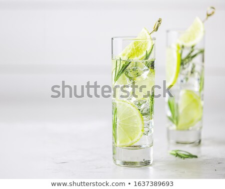Frissítő citrom citrus ital jégkockák üveg Stock fotó © artsvitlyna