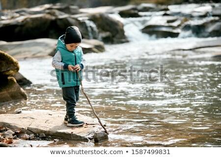 Garçon rivière bâton mains canne à pêche jeunes Photo stock © ElenaBatkova