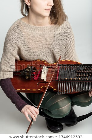 Young woman playing a traditional nyckelharpa Stock photo © Giulio_Fornasar