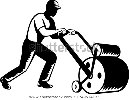 Gardener Landscaper Groundsman or Groundskeeper Pushing Lawn Mower Woodcut Black and White    Stock photo © patrimonio