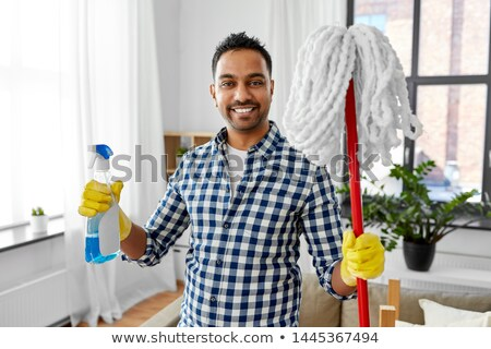 indian man with mop and detergent cleaning at home Stock photo © dolgachov