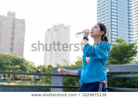 женщину питьевой осуществлять пляж Сток-фото © fxegs
