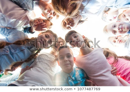 group of happy smiling diverse kids at summer camp stock photo © godfer