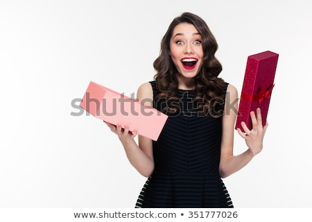 Red-haired girl in dress with present box over head Stock photo © Massonforstock