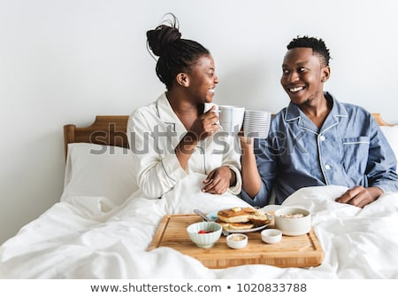 hhaving breakfast in bed stock photo © photography33