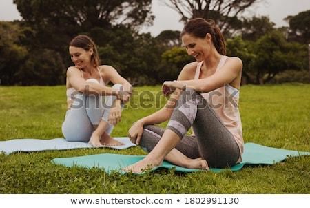 dois · mulheres · jovens · relaxante · fitness · parque · feminino - foto stock © diego_cervo