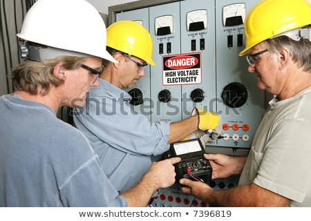 Worker performing an electrical test Stock photo © photography33