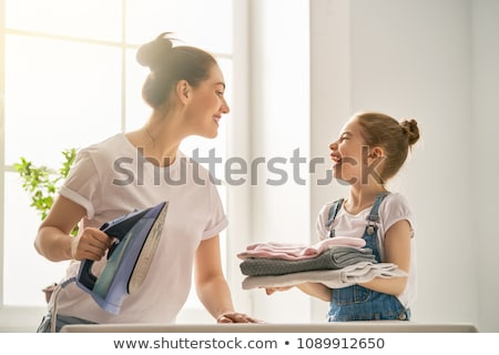 Lánygyermek vasalás ház nők munka szemüveg Stock fotó © photography33