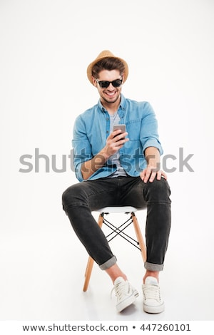 young man sitting, on the phone stock photo © feedough