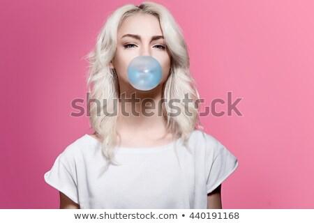 fiatal · játékos · szőke · lány · izolált · fehér - stock fotó © acidgrey