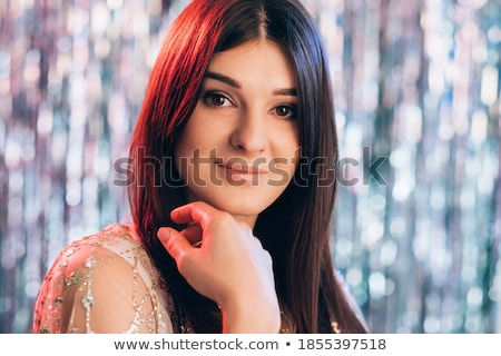 portrait of fashion brunette looks in to the lens stock photo © carlodapino